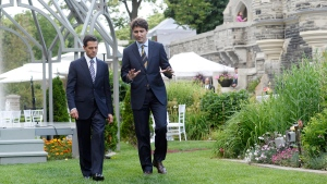 Canadian Prime Minister Justin Trudeau, right, and Mexican President Enrique Pena Nieto talk as they walk to a dinner at Casa Loma in Toronto, on Monday, June 27, 2016. (THE CANADIAN PRESS/Nathan Denette)