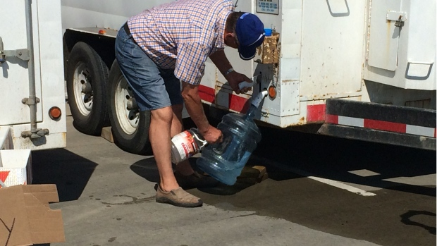 Residents using water fill stations at Fire Hall 9 Tuesday