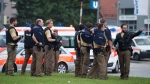 Policemen arrive at a shopping centre in which a shooting was reported in Munich, southern Germany, Friday, July 22, 2016. (Matthias Balk/dpa via AP)
