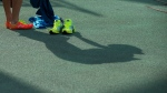 An athlete casts a shadow as she competes in the Russian Athletics Cup, at Zhukovsky, outside Moscow, Russia, Thursday, July 21, 2016. (AP / Alexander Zemlianichenko)