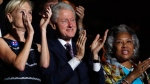 Former President Bill Clinton applauds Bernie Sanders at the Democratic National Convention in Philadelphia, on July 25, 2016. (Paul Sancya / AP)