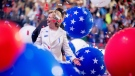 Democratic presidential candidate Hillary Clinton reacts to confetti and balloons as she stands on stage during the final day of the Democratic National Convention in Philadelphia, Thursday, July 28, 2016. (AP Photo/Andrew Harnik)