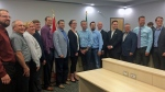 Federal Minister Ralph Goodale, third from right, and the province's Nancy Heppner, middle, pose with city officials from Warman and Martensville and contractors after announcing plans to fund two new overpasses — one on Highway 11 and one on Highway 12. (Emily Pasiuk/CTV Saskatoon)