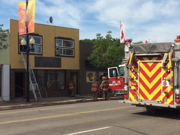 Fire crews battle a fire at a business in the 400 block of 20th Street West on July 30, 2016. (John Thronberg / CTV Saskatoon)