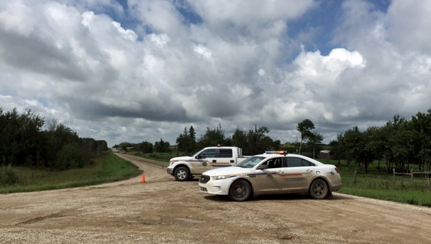 RCMP cruisers block a gravel road in the rural municipality of Glenside on Thursday, Aug. 11, 2016, following a fatal shooting days earlier on a nearby farm. (Taylor Rattray/CTV Saskatoon)