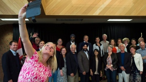 Minister of Environment and Climate Change Catherine McKenna, left, takes a selfie with members of the Liberal cabinet in Sudbury, Ont., on Sunday, Aug. 21, 2016. (THE CANADIAN PRESS/Nathan Denette)