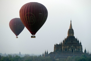 In this Tuesday Feb. 24, 2015, file photo, balloons carrying tourists fly near old temples in Bagan, Burma. (AP Photo/Khin Maung Win, File)