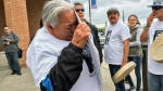 Eva Meechance hugs a photo of her great grandson Nikosis Jace Cantre outside Saskatoon's provincial court Wednesday, Aug. 24, 2016. Cantre died in hospital last month after police were called to a home on Waterloo Crescent. A 16-year-old girl is charged with second-degree murder in the case. (Calvin To/CTV Saskatoon)