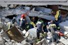 Rescuers search for victims beneath destroyed houses following Wednesday's earthquake in Pescara Del Tronto, Italy, Thursday, Aug. 25, 2016. (AP Photo/Gregorio Borgia)
