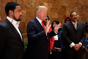 In this April 18, 2016 file photo, Pastor Darrell Scott listens at left as Republican presidential candidate Donald Trump speaks in Trump Tower building in New York. (AP / Richard Drew)