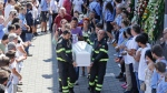 The coffin of 9-year-old Giulia Rinaldo, is carried outside the gymnasium at the end of the state funeral service in Ascoli Piceno, Italy, Saturday, Aug. 27, 2016. Funerals for some victims took place on Friday, while those for many others are expected in the coming days. (AP Photo/Gregorio Borgia)