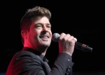 In this Aug. 7, 2015 file photo, Robin Thicke performs during the Steve Harvey Morning Show live broadcast at the Georgia World Congress Center in Atlanta. (Photo by Robb D. Cohen / Invision / AP)