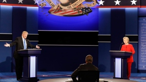 Republican presidential nominee Donald Trump answers a question as Democratic presidential nominee Hillary Clinton listens during the presidential debate at Hofstra University in Hempstead, N.Y., on Sept. 26, 2016. (David Goldman / AP)