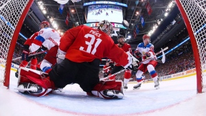 Team Russia forward Evgeny Kuznetsov (92) scores past Team Canada goalie Carey Price (31) during second period semifinal World Cup of Hockey action in Toronto on Saturday, September 24, 2016. (Bruce Bennett/THE CANADIAN PRESS)
