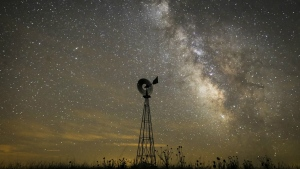 The Milky Way galaxy is seen on a moonless night from a cattle pasture in the Sand Hills of Nebraska on July 23, 2014. (Travis Heying / The Wichita Eagle)