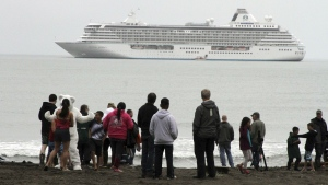 In this Aug. 21, 2016, file photo people prepare to take a polar plunge in the Bering Sea in front of the luxury cruise ship Crystal Serenity, which anchored just outside Nome, Alaska. (AP / Mark Thiessen, File)