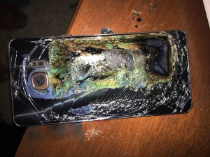 This Sunday, Oct. 9, 2016, photo shows a damaged Samsung Galaxy Note 7 on a table in Richmond, Va., after it caught fire earlier in the day. (Shawn L. Minter via AP)