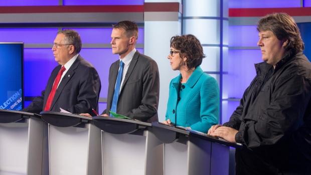 Don Atchison speaks during a Saskatoon mayoral candidates' forum as Charlie Clark, Kelley Moore and Devon Hein look on. (Gord Waldner/Postmedia)