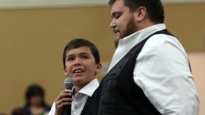Hjalmer Wenstob listens to Ucluelet Secondary Gr. 8 student Tim Masso, 13, as he sheds tears as he talks about teaching First Nations' language to his fellow classmates and about segregation at his school to Carolyn Bennett, Minister of Indigenous and Northern Affairs, at the Songhees Wellness Centre in Victoria, B.C. on Monday, October 24, 2016. (Chad Hipolito / THE CANADIAN PRESS)