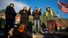 Native Americans from left, Eugene Sanchez, Jason Umtuch, Martan Mendenhall, and Hugh Ahnatock, all of Portland, Ore., drum and sing at the Oceti Sakowin camp where people have gathered to protest the Dakota Access oil pipeline in Cannon Ball, N.D., Sunday, Dec. 4, 2016. The U.S. Army Corps of Engineers said Sunday that it won't grant an easement for the Dakota Access oil pipeline in southern North Dakota, handing a victory to the Standing Rock Sioux tribe and its supporters, who argued the project would threaten the tribe's water source and cultural sites. (AP Photo/David Goldman)