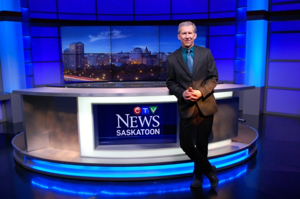 Long-time news anchor Rob MacDonald poses at the CTV Saskatoon desk during his final week with the station. He's retiring after nearly 41 years with CTV Saskatoon.