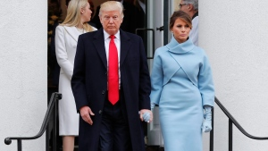 President-elect Donald Trump and his wife Melania walk out together after attending church service at St. John's Episcopal Church across from the White House in Washington, Friday, Jan. 20, 2017. (AP Photo/Pablo Martinez Monsivais)
