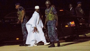Gambia's defeated leader Yahya Jammeh departs at Banjul airport Saturday Jan. 21, 2017. (AP Photo/Jerome Delay)