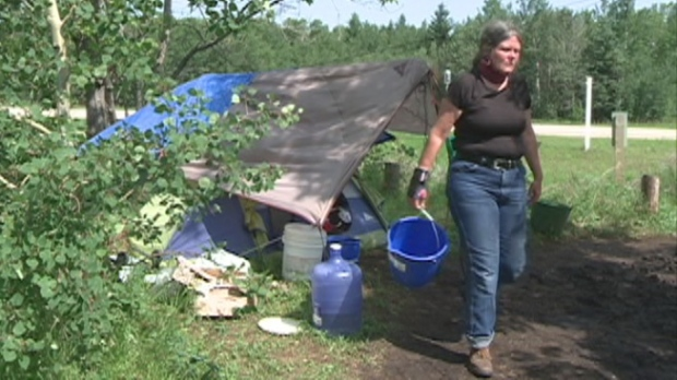 Jeanne Veronneau lives along the side of Highway #55 with her horse.