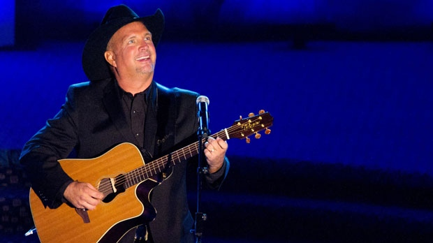 This June 16, 2011 file photo shows inductee Garth Brooks performs onstage at the 42nd Annual Songwriters Hall of Fame Awards in New York. (AP Photo/Charles Sykes)